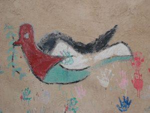 Taube mit Olivenzweig, das Symbol der Hoffnung auf Frieden an einer palästinensischen Hauswand