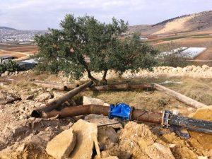 Auch die Wasserleitungen wurden zerstört; Foto © EAPPI