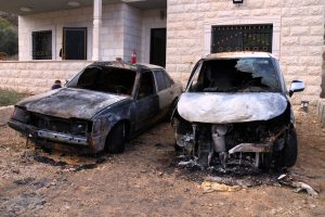 Verbrannte Autos in Urif, © EAPPI